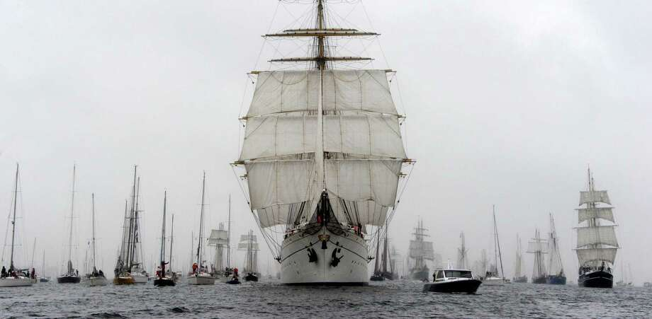 The  German Navy training ship 'Gorch Fock' , center, leads the   parade  of tall ships during the Kiel regatta week   in the Baltic Sea harbor of  Kiel, northern Germany, Saturday June 29, 2013. Photo: AP