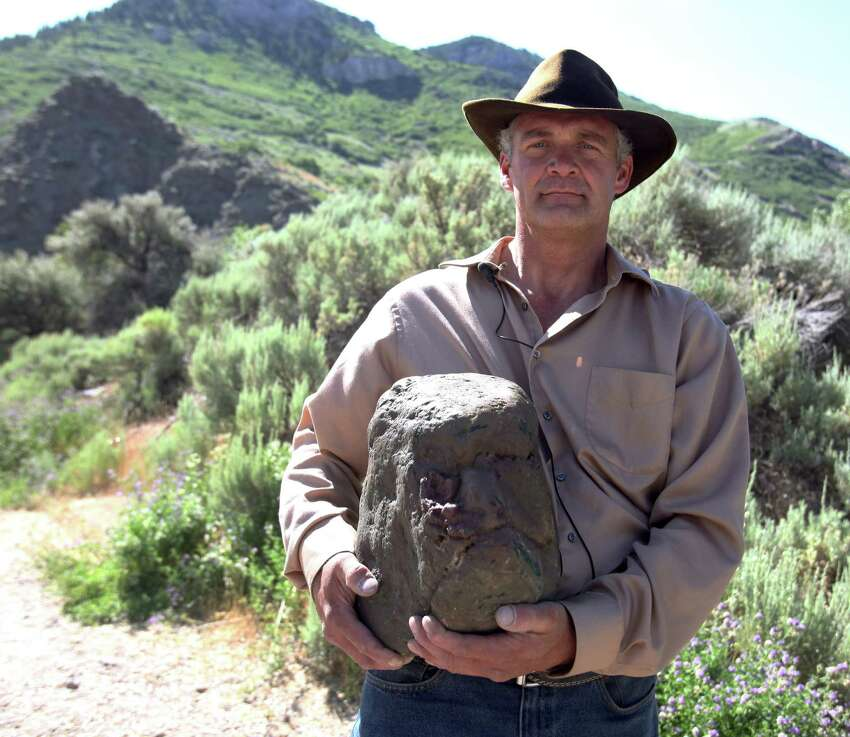 Todd May holds what he believes to be a fossilized head of a bigfoot Tuesday, June 18, 2013 in Ogden, Utah. He says he has also seen a couple of the non-fossilized, live skulls - attached to their monstrous, hairy bodies - in recent years.