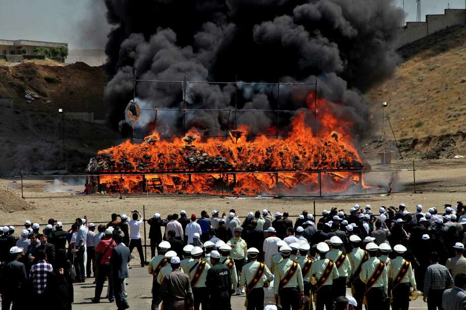 A pile of seized narcotics is set on fire, during a ceremony commemorating International Day Against Drug Abuse and Illicit Trafficking, in north Tehran, Iran, Wednesday, June 26, 2013. Iran has burned at least 100 tons of illicit drugs as part of its efforts to fight drug smuggling. Iranian authorities and foreign guests watched as some 50 tons of various narcotics were burned in north Tehran at a ceremony on Wednesday to mark the UN International Day Against Drug Abuse and Illicit Trafficking. Some 50 other tons were destroyed in several other Iranian cities. Photo: AP