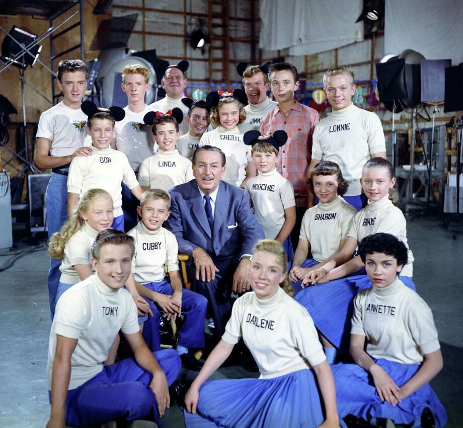 "This 1957 publicity photo released by The Walt Disney Company shows the Mouseketeers, including Annette, front right, with Walt Disney, center. Spin, (Tim Considine), top left, Marty, (David Stollery ), top second left, and Tommy Kirk, top second right, appeared on the ""Mickey Mouse Club"" television show in serials ""Spin and Marty"" and ""The Hardy Boys."" The stage at Walt Disney Studios where ""The Mickey Mouse Club"" was filmed is now officially the Annette Funicello Stage. Disney chief Bob Iger led a ceremony Monday, June 24, 2013, dedicating the soundstage to Funicello, the Mouseketeer-turned-movie star who died in April at age 70. Photo: AP"