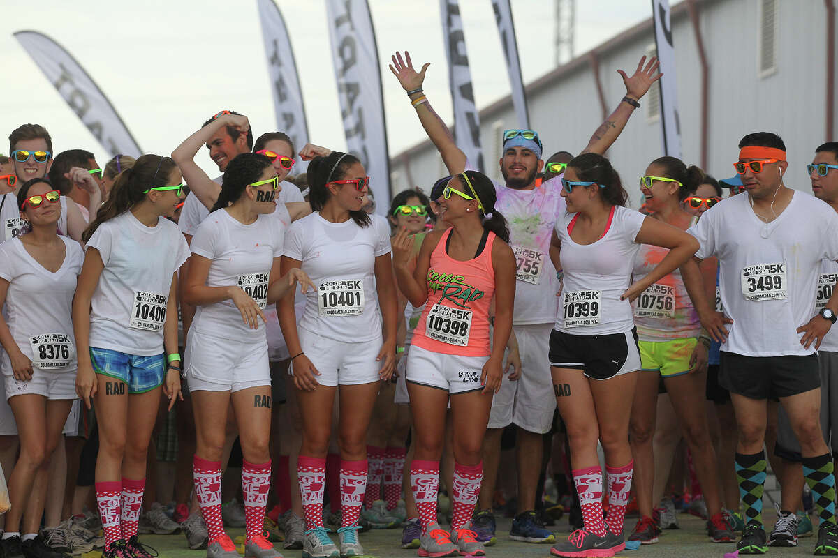 Participants line up at the start of San Antonio Color Me Rad 5K at the Freeman Coliseum, Sunday, June 30, 2013. Thousands participated in the race that benefitted the Ronald McDonald House Charities. It is part of a national series of races.
