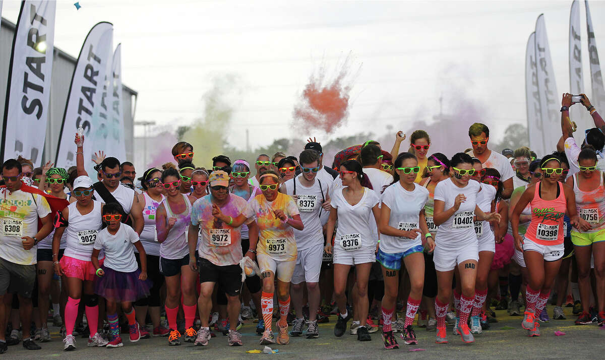 Participants start the San Antonio Color Me Rad 5K at the Freeman Coliseum, Sunday, June 30, 2013. The Color Me Rad race drew thousands with proceeds benefiting the Ronald McDonald House Charities.