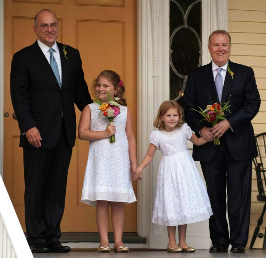 13. New York Pictured: Jonathan Mintz (L), the city's consumer affairs commissioner, John Feinblatt (R), a chief adviser to the mayor, before their wedding ceremony, along with their daughters Maeve (2nd L) and Georgia (2nd R) at Gracie Mansion in New York in 2011. Hundreds of gay and lesbian New Yorkers were married that weekend, as the Empire State becomes the sixth state in the U.S. to embrace same-sex marriage.