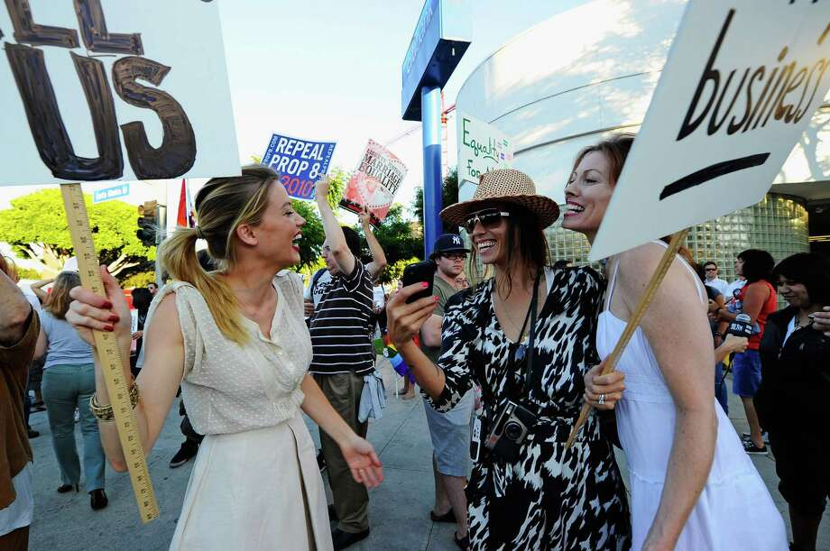 "5. Riverside, Calif.""Part of the Inland Empire, this city ranked thanks to its high number of DJs, photographers, and wedding planners,"" stated the Real estate brokerage Movoto's blog.Pictured:  A same-sex marriage advocates demonstration against the stay barring gay marriages in 2010 in California. Photo: Kevork Djansezian, Getty Images / 2010 Getty Images"