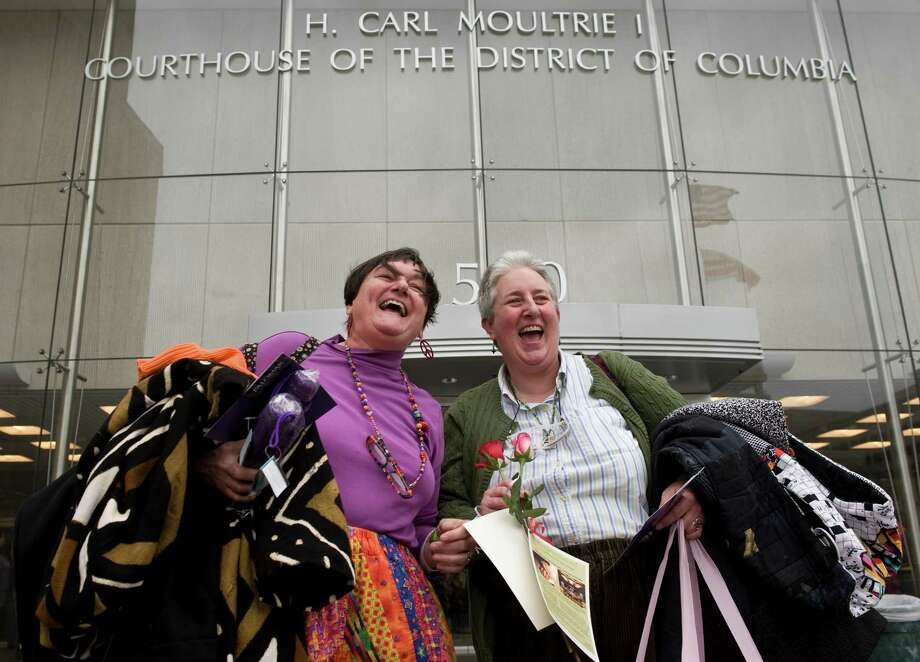 "6. Washington, D.C.""The nation's capital made our list thanks to its numerous gay-friendly bars and large gay population,"" stated the Real estate brokerage Movoto's blog.Pictured: A couple after applying for their marriage license in DC Suprior Court in 2010. Photo: Bill Clark, Getty Images / © 2010 Roll Call Photos"