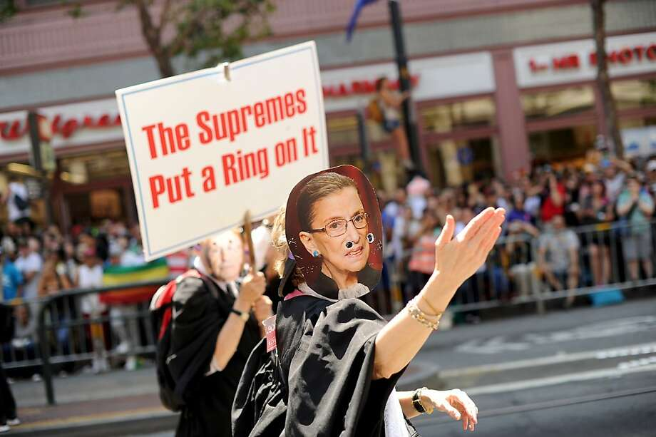 Wearing a mask of U.S. Supreme Court Justice Ruth Bader Ginsburg, a reveler marches in San Francisco's 43rd annual gay pride parade Sunday, June 30, 2013. Participants bore signs and clothing celebrating the court's Wednesday ruling that cleared the way for same-sex marriages to resume in California. (AP Photo/Noah Berger) Photo: Noah Berger, Associated Press