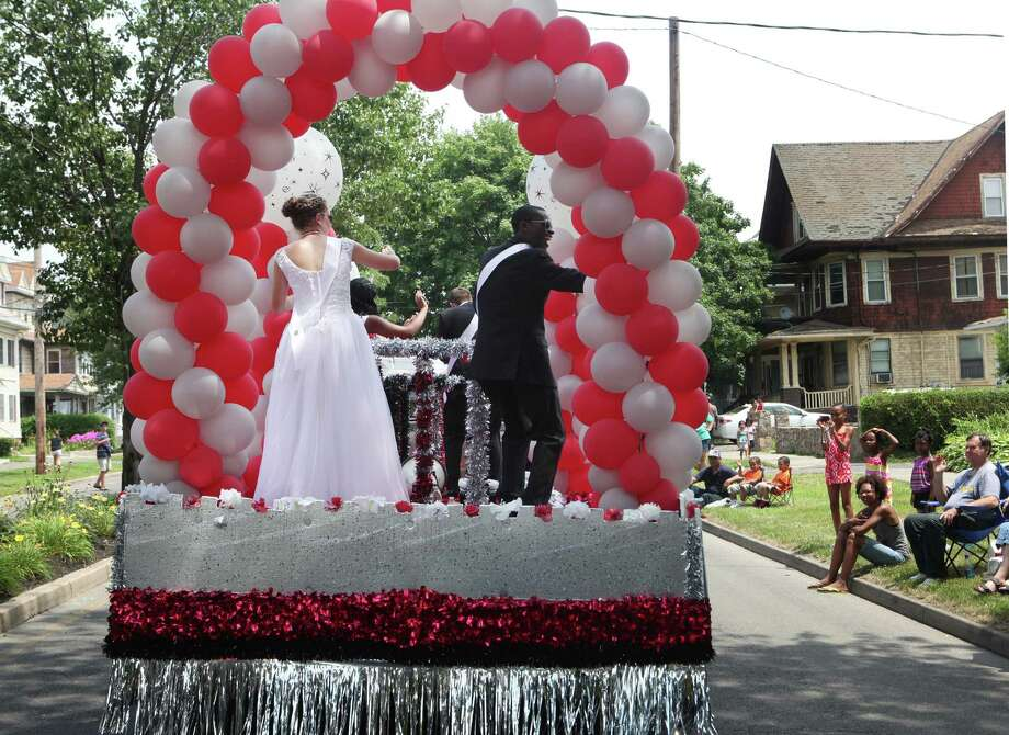 Barnum Festival Queen Maggie Bodington and King Shyheim Snead  wave during The Great Street Parade on North Ave. In Bridgeport, Conn, on Sunday, June 30, 2013. Photo: BK Angeletti, B.K. Angeletti / Connecticut Post freelance B.K. Angeletti