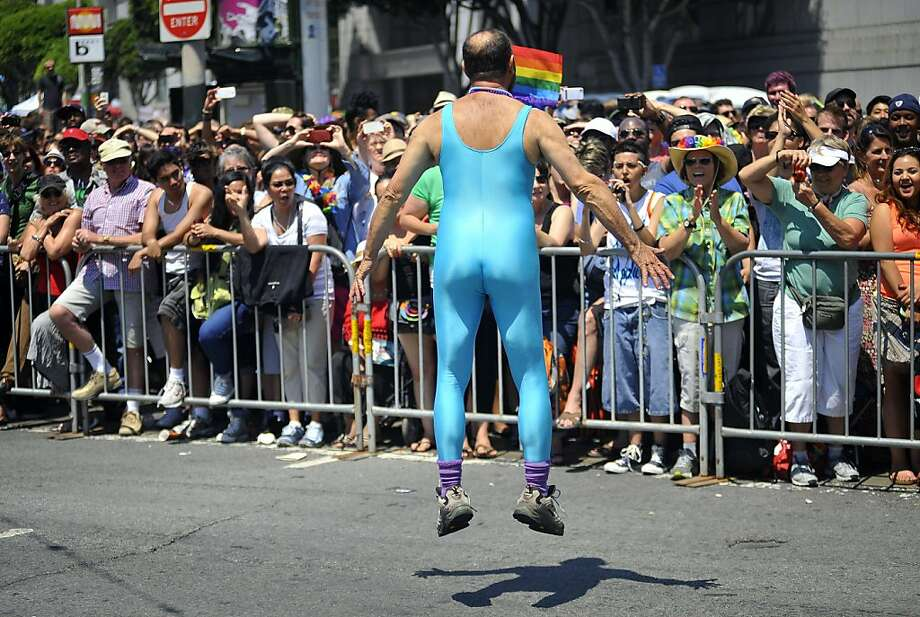 A gay rights supporter jumps with excitement along the parade route during the Pride parade in 2013. Photo: Josh Edelson, AFP/Getty Images