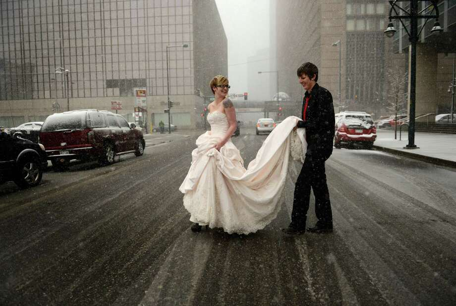 7. DenverErin Ivie, 23, left, and her partner Kristyn Lindstrom, 25, leave to do wedding photos, outside in the snow, after their civil-union  ceremony in downtown Denver, May 01, 2013. Photo: RJ Sangosti, Getty Images / Copyright - 2013 The Denver Post, MediaNews Group.