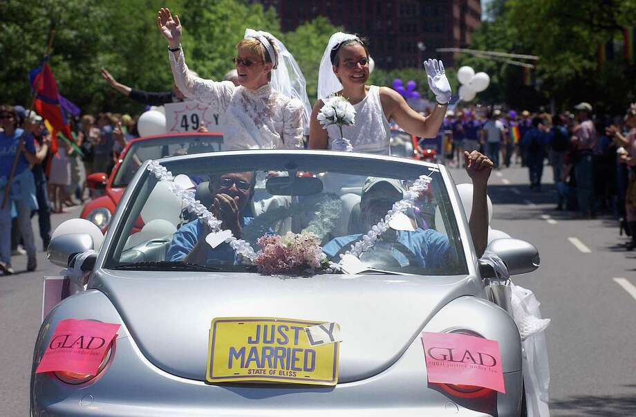 "6. Boston""Beantown ranked in the top 10 thanks to its number of florists, bakeries, and photographers,"" stated the Real estate brokerage Movoto's blog.Pictured:  Moira Barrett (L) and Johanna Schulman, of Cambridge, ride in a car in 2004 during the 34th annual Boston Gay Pride Parade in Boston, Mass. That year marked the first time the parade took place since the state legalized same sex marriage, and officials expect the turnout to be the highest in the parades history. Photo: Darren McCollester, Getty Images / 2004 Getty Images"