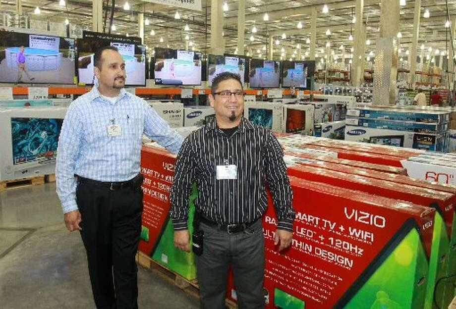J.P. Polloreno, left, and Manual Juarez of Costco, in the major sales department.