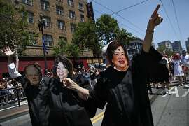 "People marching with the National Center for Lesbian Rights dressed as the Supreme Court justices and held a sign that read, ""The Supremes put a ring on it"" during the Pride parade in San Francisco, Calif., on Sunday, June 30, 2013."