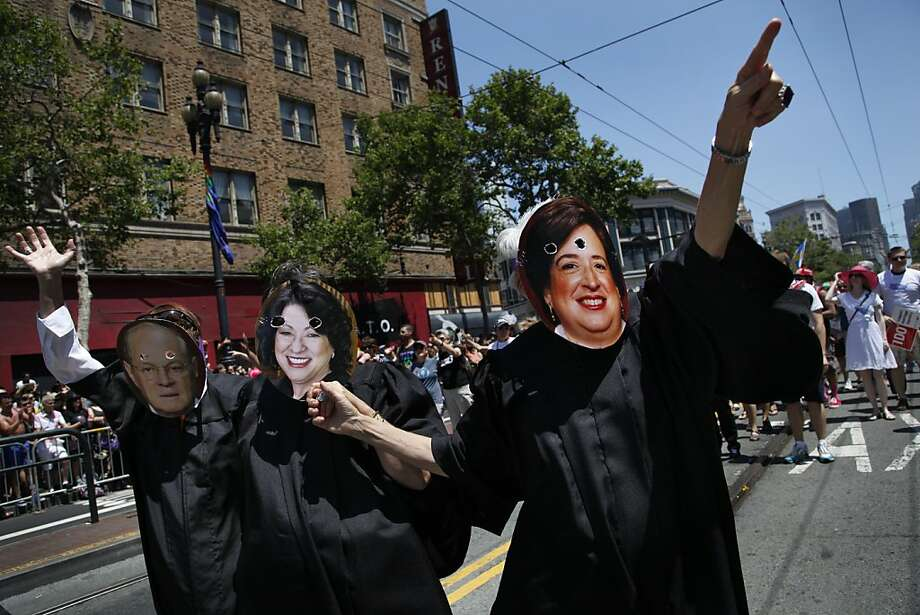 Gay Pride Parade marchers from the National Center for Lesbian Rights dress as U.S. Supreme Court justices who helped write last week's ruling granting federal benefits to gay spouses: Anthony Kennedy (left), Sonia Sotomayor and Elena Kagan. Photo: Preston Gannaway, Special To The Chronicle