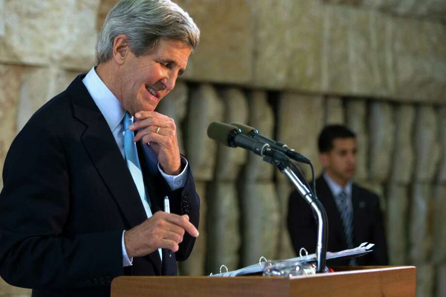 U.S. Secretary of State John Kerry smiles at a question from a reporter during a news conference about his trip to the Middle East, in Tel Aviv, Israel on Sunday, June 30, 2013. Kerry engaged in breakneck shuttle diplomacy to coax Israel and the Palestinians back into peace talks over a four-day span with multiple trips to Jordan and Israel and a stop in the West Bank town of Ramallah. (AP Photo/Jacquelyn Martin, Pool) Photo: Jacquelyn Martin, POOL / AP POOL