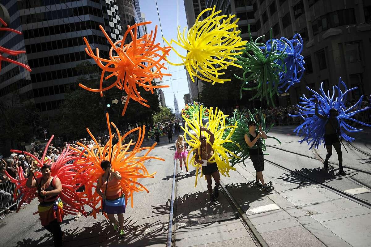 Members of Ballon Magic SF make their way along Market Street during last year's Pride Parade.