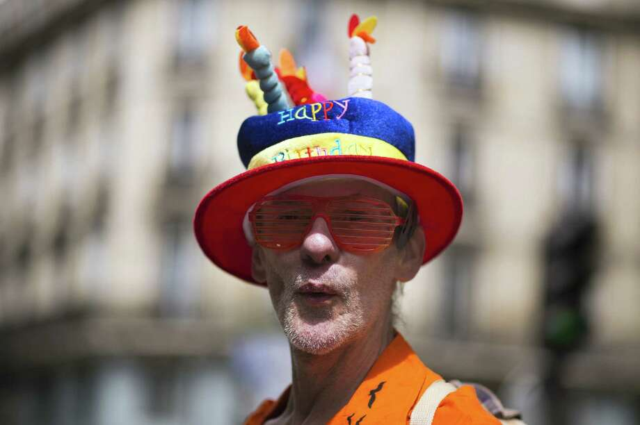 A man parades during the homosexual, lesbian, bisexual and transgender (HLBT) visibility march, the Gay Pride, on June 29, 2013 in Paris, exactly one month after France celebrated its first gay marriage. AFP PHOTO / LIONEL BONAVENTURELIONEL BONAVENTURE/AFP/Getty Images Photo: LIONEL BONAVENTURE, AFP/Getty Images / AFP