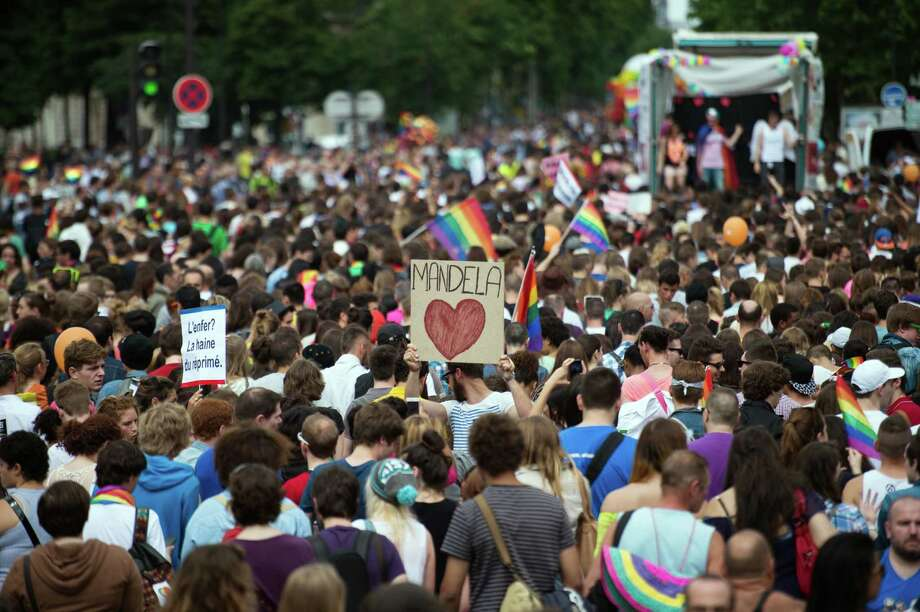 People parade during the homosexual, lesbian, bisexual and transgender (HLBT) visibility march, the Gay Pride, on June 29, 2013 in Paris, exactly one month to the day since France celebrated its first gay marriage. AFP PHOTO / MARTIN BUREAUMARTIN BUREAU/AFP/Getty Images Photo: MARTIN BUREAU, AFP/Getty Images / AFP