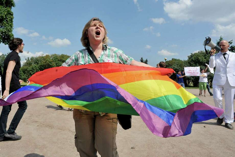 A gay rights activist holds a rainbow flag as she takes part in a gay pride event in Saint Petersburg on June 29, 2013. Russian police arrested dozens of people on June 29 after clashes erupted in the city of Saint Petersburg between pro- and anti-gay demonstrators. AFP PHOTO / OLGA MALTSEVAOLGA MALTSEVA/AFP/Getty Images Photo: OLGA MALTSEVA, AFP/Getty Images / AFP