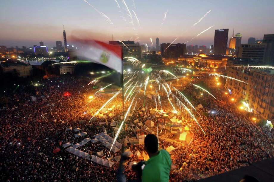 Hundreds of thousands of opponents of Egypt's Islamist president poured into Cairo's Tahrir Square and in cities across much of the nation Sunday in protests demanding that Mohammed Morsi resign. Photo: Amr Nabil, STF / AP