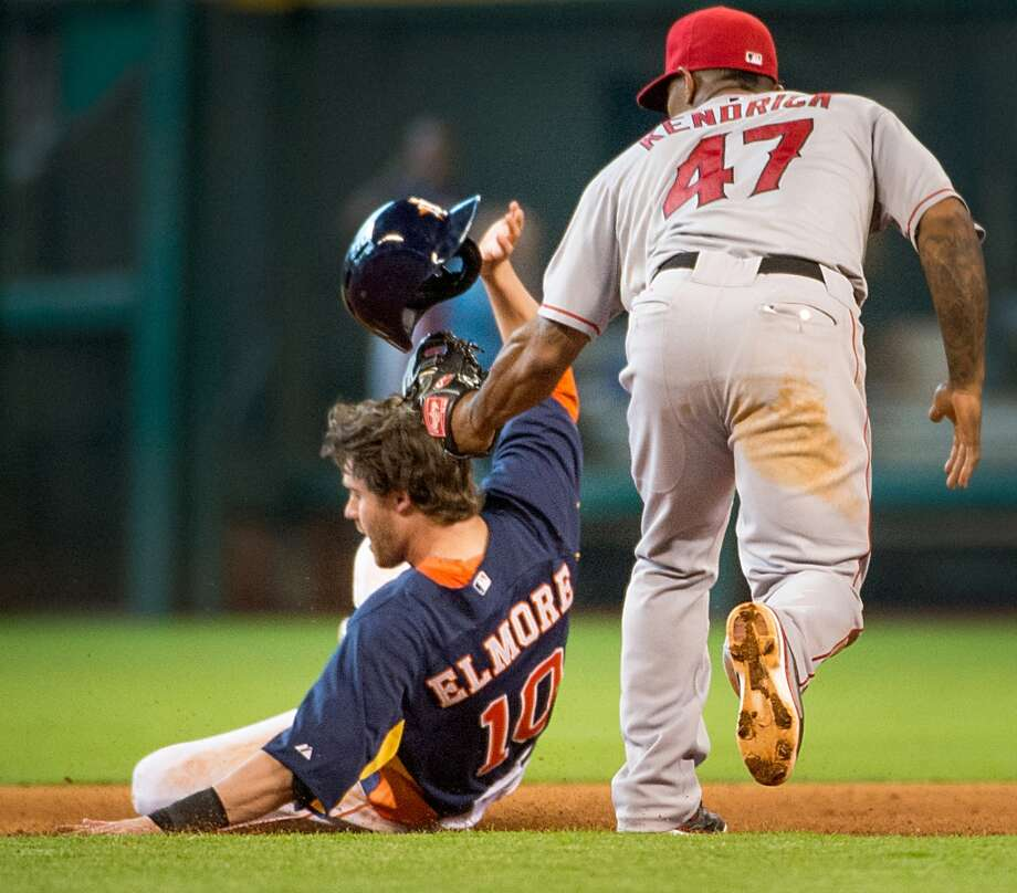 Astros shortstop Jake Elmore is out at second base as Angels second baseman Howie Kendrick applies the tag during the eighth inning.