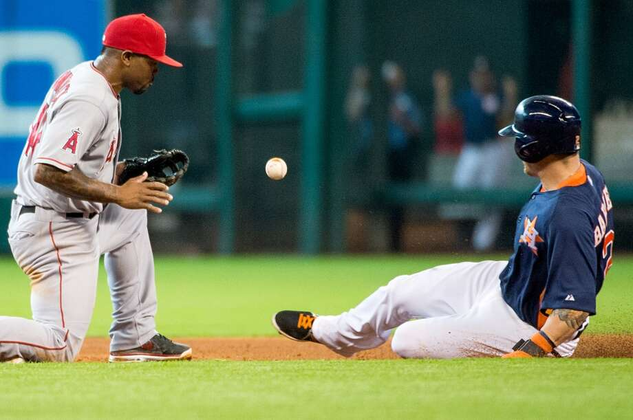 Astros center fielder Brandon Barnes is safe at second with a stolen base as the ball gets away from Angels second baseman Howie Kendrick.