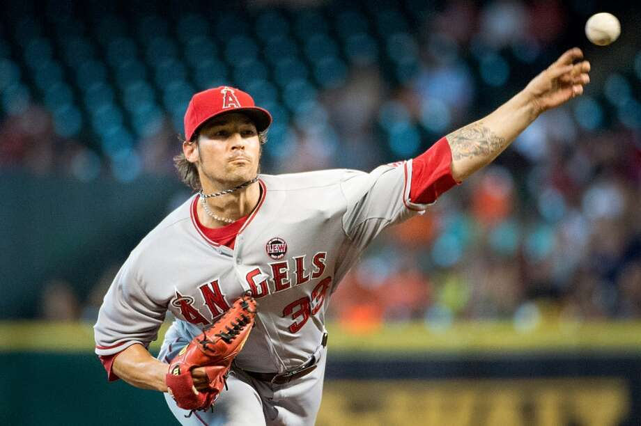 Angels starting pitcher C.J. Wilson pitches during the first inning.