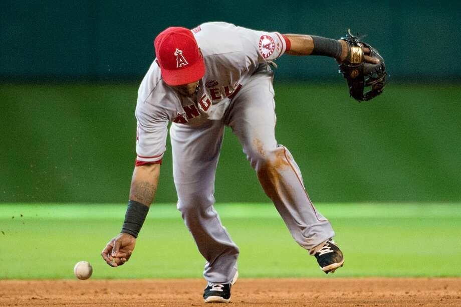Angels shortstop Erick Aybar can't make the play on a single by the J.D. Martinez during the ninth inning.