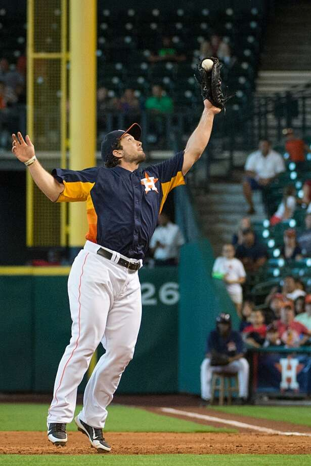 Astros first baseman Brett Wallace reaches up to snare a line drive off the bat of Angels left fielder J.B. Shuck to start an unassisted double play during the ninth inning.