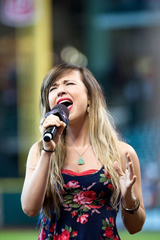 "Savannah Berry from NBC's ""The Voice"" sings the national anthem before the Astros face the  Angels at Minute Maid Park."