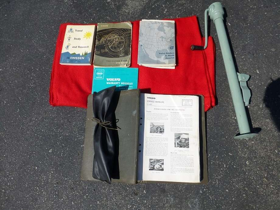 Books, tools and jack from Robert Fuller's 1959 Volvo.