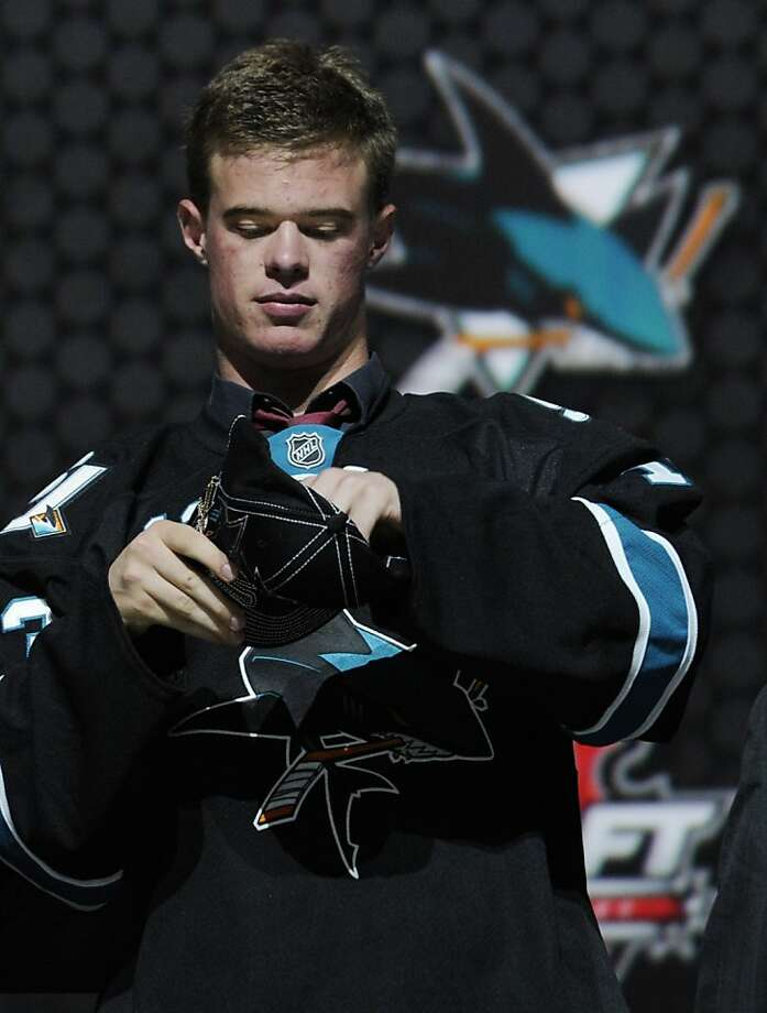 Swiss player Mirco Mueller, a defenseman, was chosen 18th overall by the Sharks in the first round of Sunday's NHL draft. Photo: Bill Kostroun, Associated Press