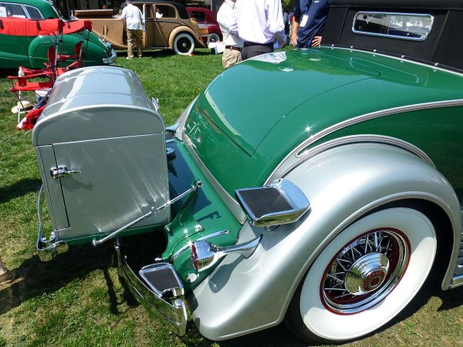 The Packard convertible has a couple of steps to help passengers get into the rumble seat.