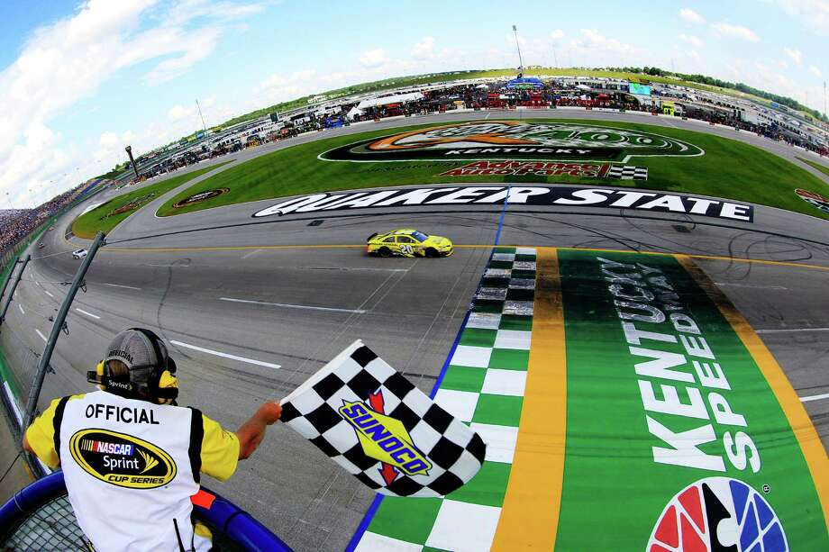 SPARTA, KY - JUNE 30:  (HANDOUT PHOTO, NO ARCHIVE, NO SALES, ONE TIME EDITORIAL USE ONLY) In this photo provided by NASCAR, Matt Kenseth, driver of the #20 Dollar General Toyota, races to the checkered flag to win the NASCAR Sprint Cup Series Quaker State 400 at Kentucky Speedway on June 30, 2013 in Sparta, Kentucky.  (Photo by Sean Gardner/NASCAR via Getty Images) ORG XMIT: 159334193 Photo: Sean Gardner / 2013 NASCAR