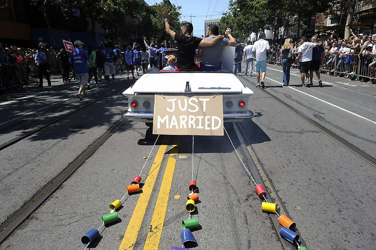 Cans are seen tied to the back of Proposition 8 plaintiffs Jeff Zarrillo and Paul Katami during the Annual Pride Parade in San Francisco, CA Sunday June 30th, 2013.
