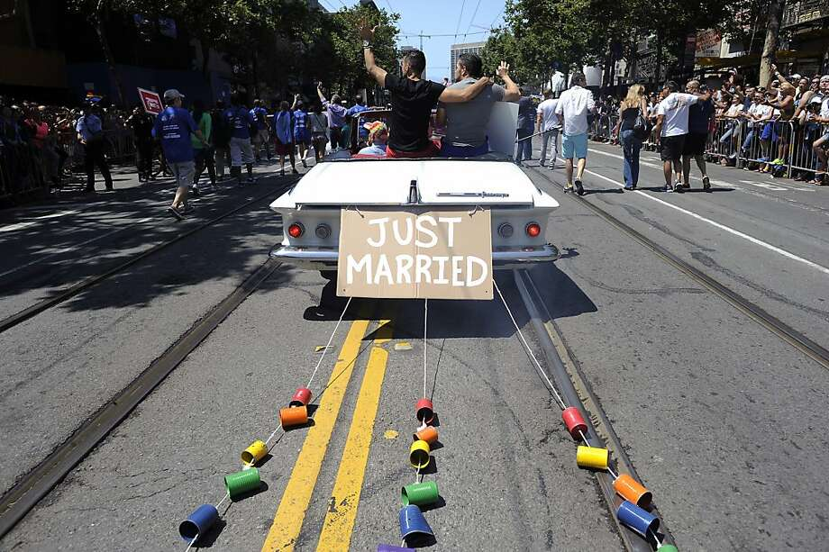 Cans are tied to a car carrying anti-Proposition 8 plaintiffs Jeff Zarrillo and Paul Katami during the Pride Parade on June 30. Photo: Michael Short, Special To The Chronicle