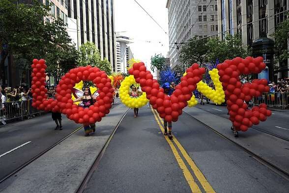 The group Ballon Magic makes it's way down Market St. during the Annual Pride Parade in San Francisco, CA Sunday June 30th, 2013.