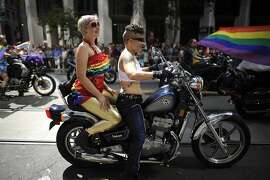 Members of Dykes on Bike head down Market St. marking the start of the Annual Pride Parade in San Francisco, CA Sunday June 30th, 2013.