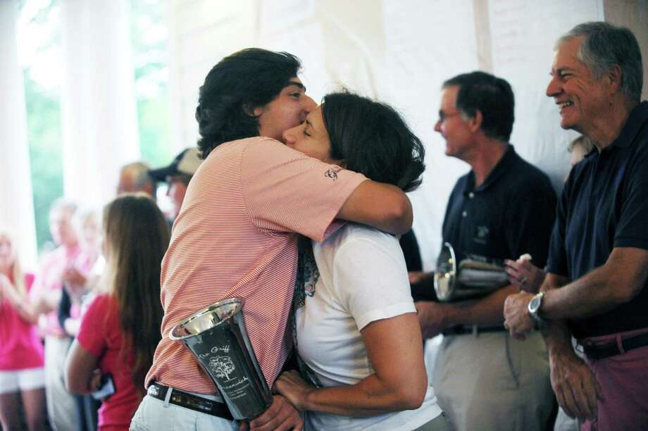 Paul Pastore hugs his mother Laura when she found her son won the Greenwich Townwide Golf championships at Griffith E. Harris Golf Club, in Greenwich, Conn., Sunday, June 3013. Photo: Helen Neafsey / Greenwich Time