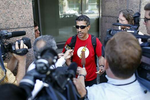 Leo Ruiz, a spokesman for Amalgamated Transit Union Local 1555 speaks with the media before a negotiations meeting with BART officials at the Caltrans building in Oakland, Calif. on June 30, 2013. Photo: Ian C. Bates, The Chronicle