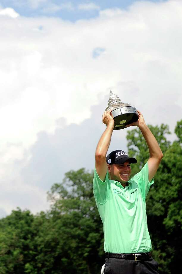 BETHESDA, MD - JUNE 30:  Bill Haas holds up the trophy after winning the AT&T National at Congressional Country Club on June 30, 2013 in Bethesda, Maryland.  (Photo by Patrick McDermott/Getty Images) ORG XMIT: 159809758 Photo: Patrick McDermott / 2013 Getty Images