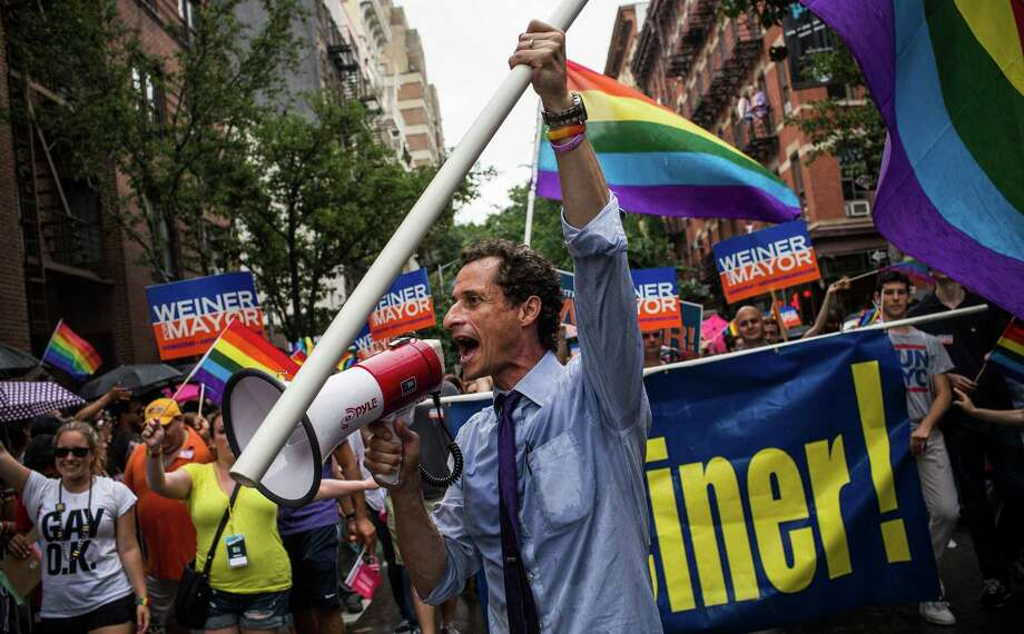 New York City mayoral candidate Anthony Weiner marches in the New York Gay Pride Parade on Sunday in New York City.  This year's parade was a particularly festive occasion, due to the recent Supreme Court Ruling that it was unconstitutional to ban gay marriage.  (Photo by Andrew Burton/Getty Images) Photo: Andrew Burton, Staff / 2013 Getty Images