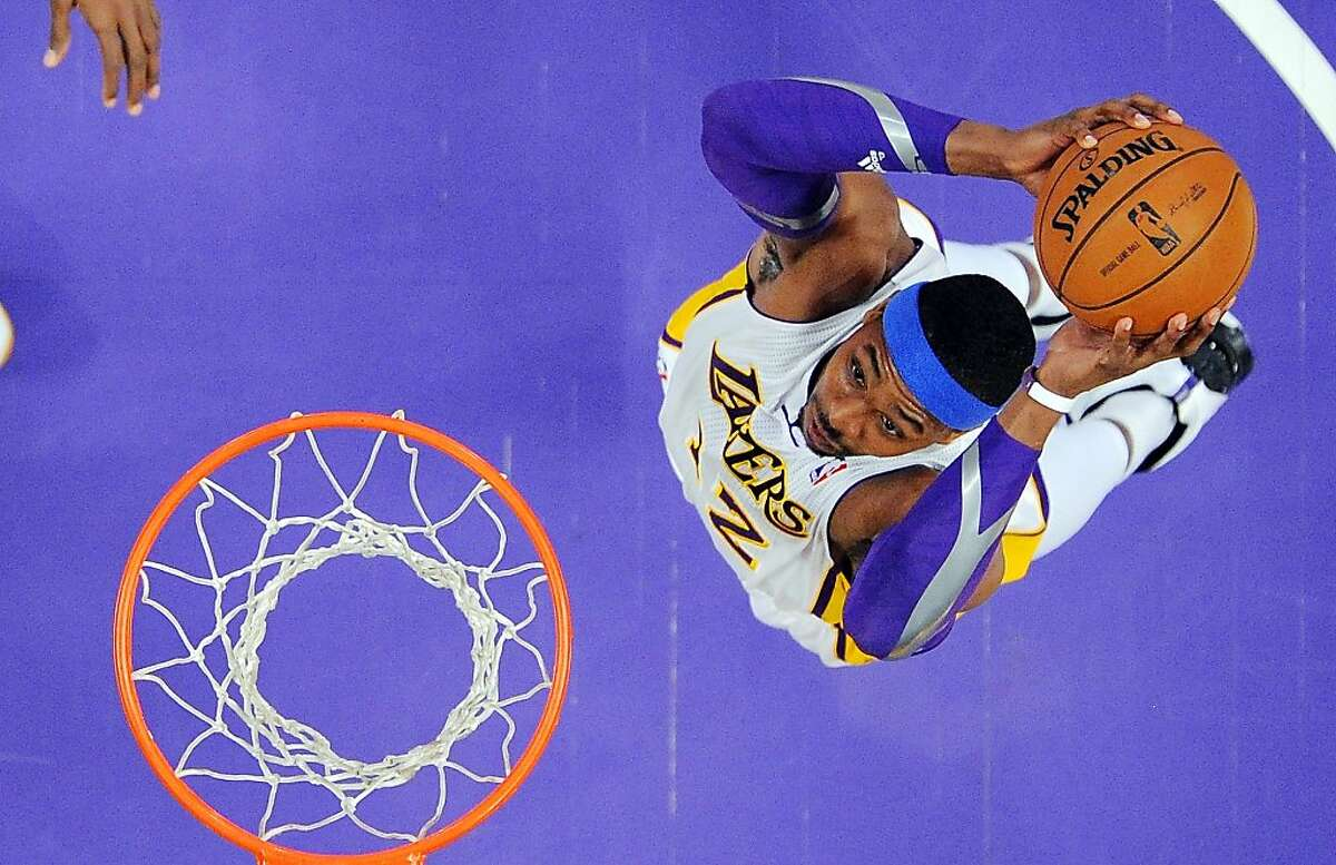 Los Angeles Lakers center Dwight Howard goes up for a dunk during the first half of their NBA basketball game against the Oklahoma City Thunder, Sunday, Jan. 27, 2013, in Los Angeles. The Lakers won 105-96. (AP Photo/Reed Saxon)