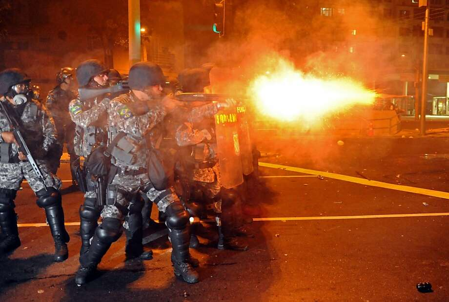 Riot squad officers clash with protesters near Maracana Stadium on Sunday. Photo: Tasso Marcelo, AFP/Getty Images