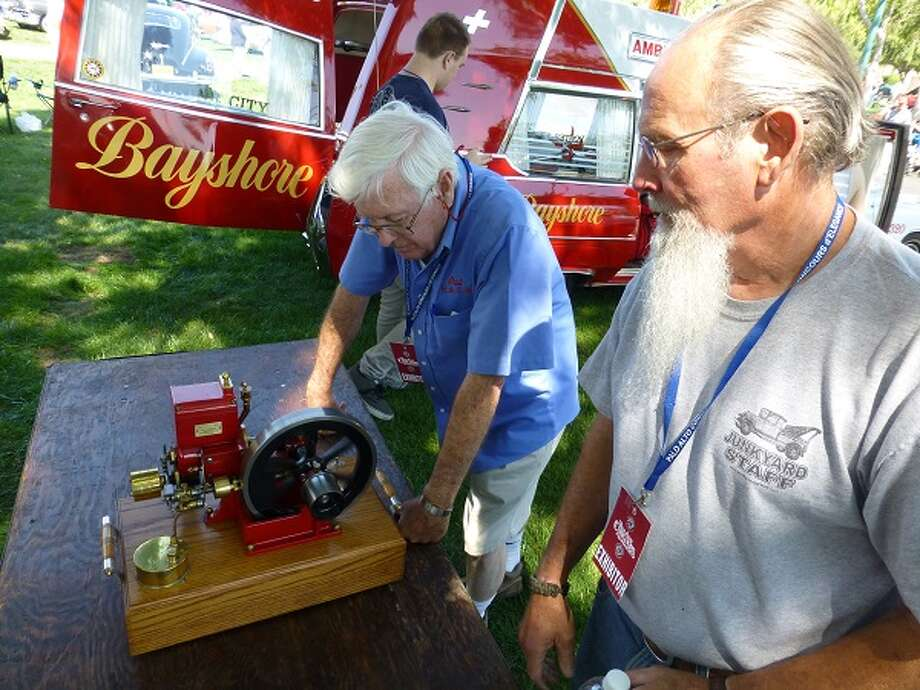 "Al Aldrich (right), of the Bay Area Engine Modelers Club, displays a Vaughn ""hit and miss"" engine, a one-third scale replica of a 1910 engine."