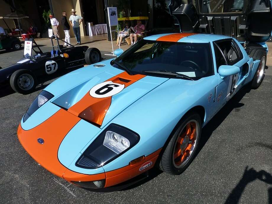 2006 Ford GT. This happens to be one of my all-time favorite cars. It's Ford's 2005-07 recreation of the 1960s-era Le Mans-winnning GT40 and its descendants. Note that this one is painted in the Gulf-Wyer racing team colors. Owner: Tom Piana.  (All photos by Michael Taylor)