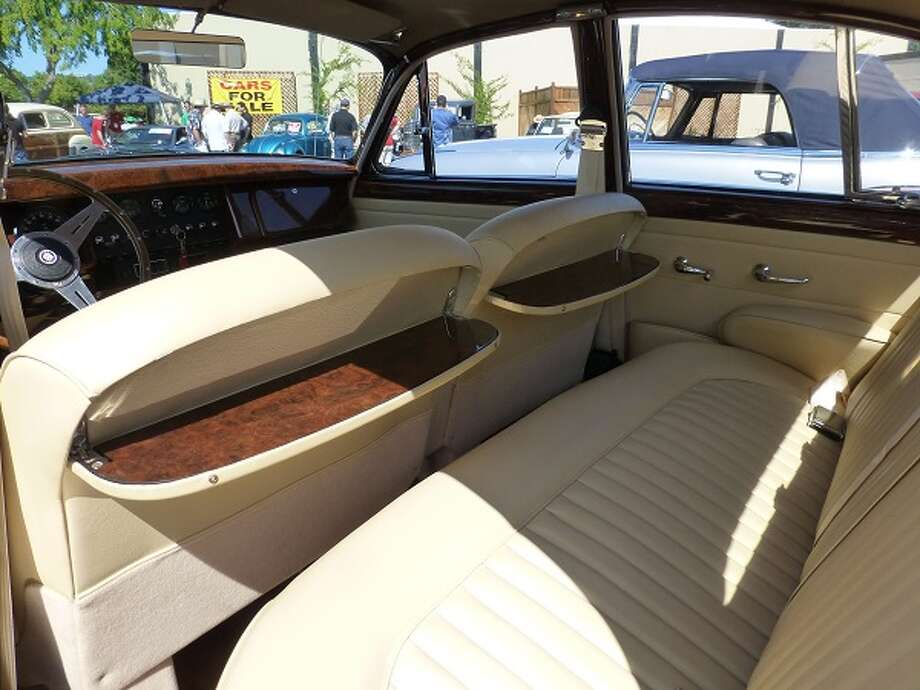 Tea tables in the rear seat area of Gabriele Lanusse's Jaguar.