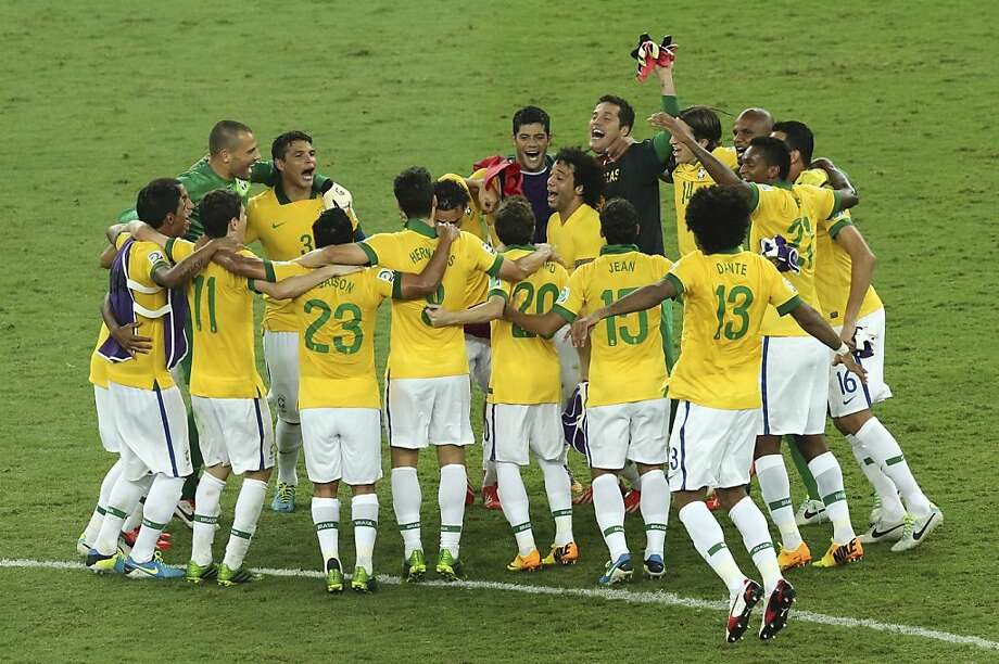 Brazil players celebrate winning the soccer Confederations Cup final a year ahead of the 2014 World Cup. Photo: Eugene Hoshiko, Associated Press