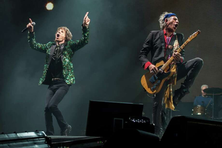 Sir Mick Jagger and Keith Richards of The Rolling Stones perform on the Pyramid Stage during day 3 of the 2013 Glastonbury Festival at Worthy Farm on June 29, 2013 in Glastonbury, England.  The festival attracts 170,000 party-goers to the dairy farm in Somerset,