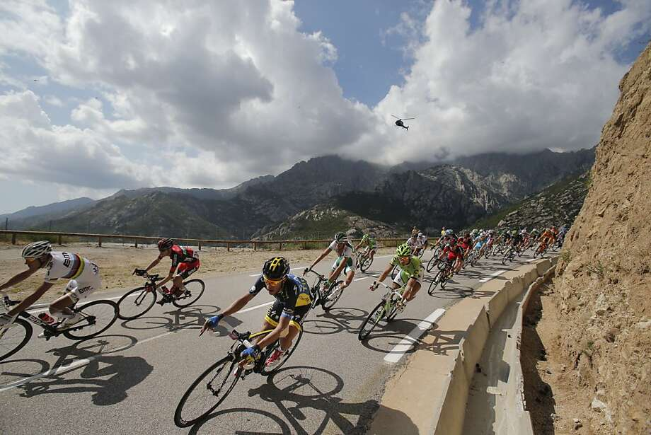 Spain's Alberto Contador, center in blue and yellow, speeds down Vizzavona pass during the second stage of the Tour de France cycling race over 156 kilometers (97.5 miles) with start in Bastia and finish in Ajaccio, Corsica island, France, Sunday June 30, 2013. (AP Photo/Christophe Ena) Photo: Christophe Ena, Associated Press