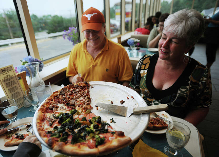 Long time customers Randall and Beth Colette of Derby enjoy a pizza dinner at Stella's Restaurant in Stratford on Sunday, June 30, 2013. The restaurant received a makeover by the television show Restaurant: Impossible in August of last year. Photo: Brian A. Pounds / Connecticut Post